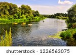 kayakers on summer forest river ... | Shutterstock . vector #1226563075