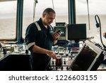 marine navigational officer is... | Shutterstock . vector #1226603155