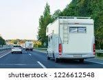 camper rv on the road  slovenia. | Shutterstock . vector #1226612548