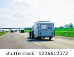 camper rv at the road in poland. | Shutterstock . vector #1226612572