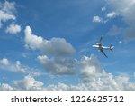 airplane flying in blue sky... | Shutterstock . vector #1226625712