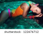 a beatiful girl in swimming... | Shutterstock . vector #122676712