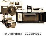 The 35mm camera with film opened back side. - stock photo