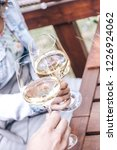 couple cheers with white wine | Shutterstock . vector #1226924062