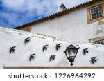 Stock photo black small ceramic swallow bird andorinha decoration and a small street lamp situated on the 1226964292