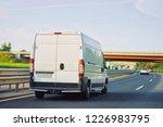 mini van on the highway road in ... | Shutterstock . vector #1226983795