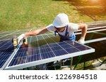 professional worker installing... | Shutterstock . vector #1226984518