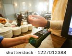 cashier holding payment machine ... | Shutterstock . vector #1227012388