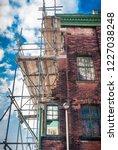victorian house undergoing... | Shutterstock . vector #1227038248