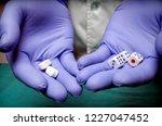 doctor holds left hand three... | Shutterstock . vector #1227047452