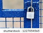 A Blue Metallic Fence With A...