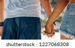 rear view close up of hands of... | Shutterstock . vector #1227068308