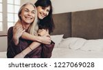 smiling woman holding her... | Shutterstock . vector #1227069028