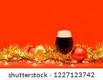 snifter glass of dark ale or... | Shutterstock . vector #1227123742