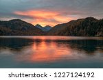 picturesque sunset over alpsee...   Shutterstock . vector #1227124192