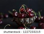 close up of fresh cherries in... | Shutterstock . vector #1227233215
