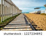 boardwalk that sees to the sea | Shutterstock . vector #1227234892