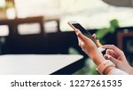woman using smartphone  during... | Shutterstock . vector #1227261535