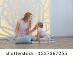 beautiful blonde mother and...   Shutterstock . vector #1227367255