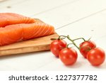 red fish on a wooden white table | Shutterstock . vector #1227377782
