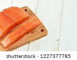 red fish on a wooden white table | Shutterstock . vector #1227377785