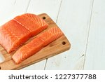red fish on a wooden white table | Shutterstock . vector #1227377788