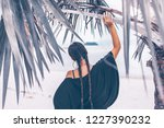 boho style young woman with tresses on the beach