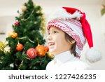 arabic cute boy with new year... | Shutterstock . vector #1227426235