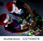 two boys with christmas tree... | Shutterstock . vector #1227430078