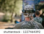 back view of man in camouflage... | Shutterstock . vector #1227464392