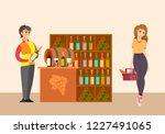 sommelier with customer in... | Shutterstock .eps vector #1227491065