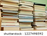 stack of books in library | Shutterstock . vector #1227498592