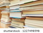 stack of books in library | Shutterstock . vector #1227498598