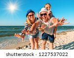 happy family on the beach.... | Shutterstock . vector #1227537022