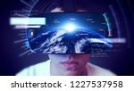young man wearing vr headset... | Shutterstock . vector #1227537958