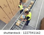 worker in a warehouse in the... | Shutterstock . vector #1227541162