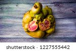pomegranate fruit on a wooden... | Shutterstock . vector #1227555442