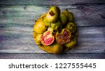pomegranate fruit on a wooden... | Shutterstock . vector #1227555445