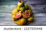 pomegranate fruit on a wooden... | Shutterstock . vector #1227555448
