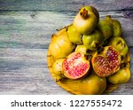 pomegranate fruit on a wooden... | Shutterstock . vector #1227555472