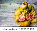 pomegranate fruit on a wooden... | Shutterstock . vector #1227555478