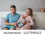 portrait of happy young parents ...   Shutterstock . vector #1227598312