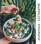 healthy green vegan salad   Shutterstock . vector #1227666958
