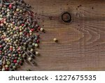 mix of peppercorns on rustic... | Shutterstock . vector #1227675535