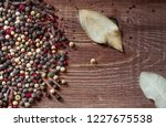 mix of peppercorns on rustic... | Shutterstock . vector #1227675538