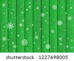 christmas snowfall on green... | Shutterstock .eps vector #1227698005