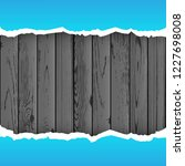 blue torn paper on dark wood... | Shutterstock .eps vector #1227698008