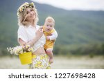 happy family in nature. woman... | Shutterstock . vector #1227698428