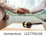 judge gavel with lawyers having ... | Shutterstock . vector #1227700138