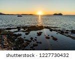 sunset at a beach of the aegean ...   Shutterstock . vector #1227730432